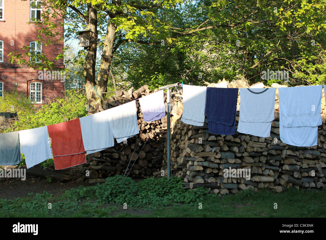 Clean laundry getting dry outside at free town Christiania, Copenhagen, Denmark - Stock Image