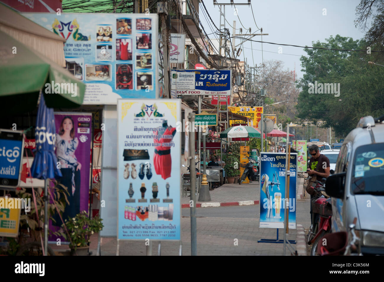 Busy Quai Fa Ngum street catering to tourists, Vientiane Laos - Stock Image