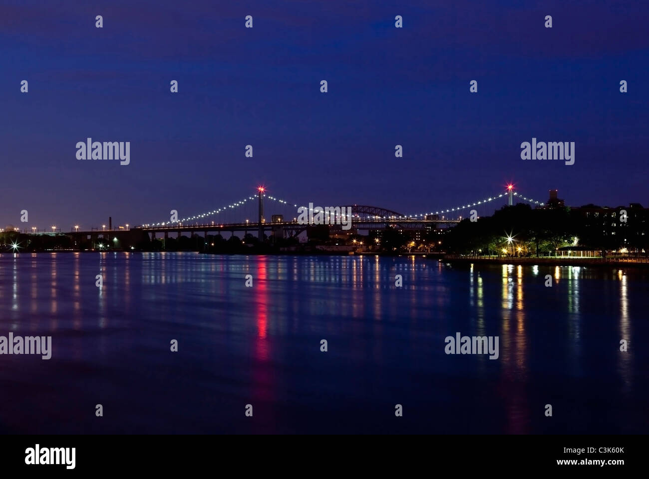 Triboro Bridge Recently Renamed The Robert F. Kennedy (RFK) Bridge, East River at Night, New York City, USA - Stock Image