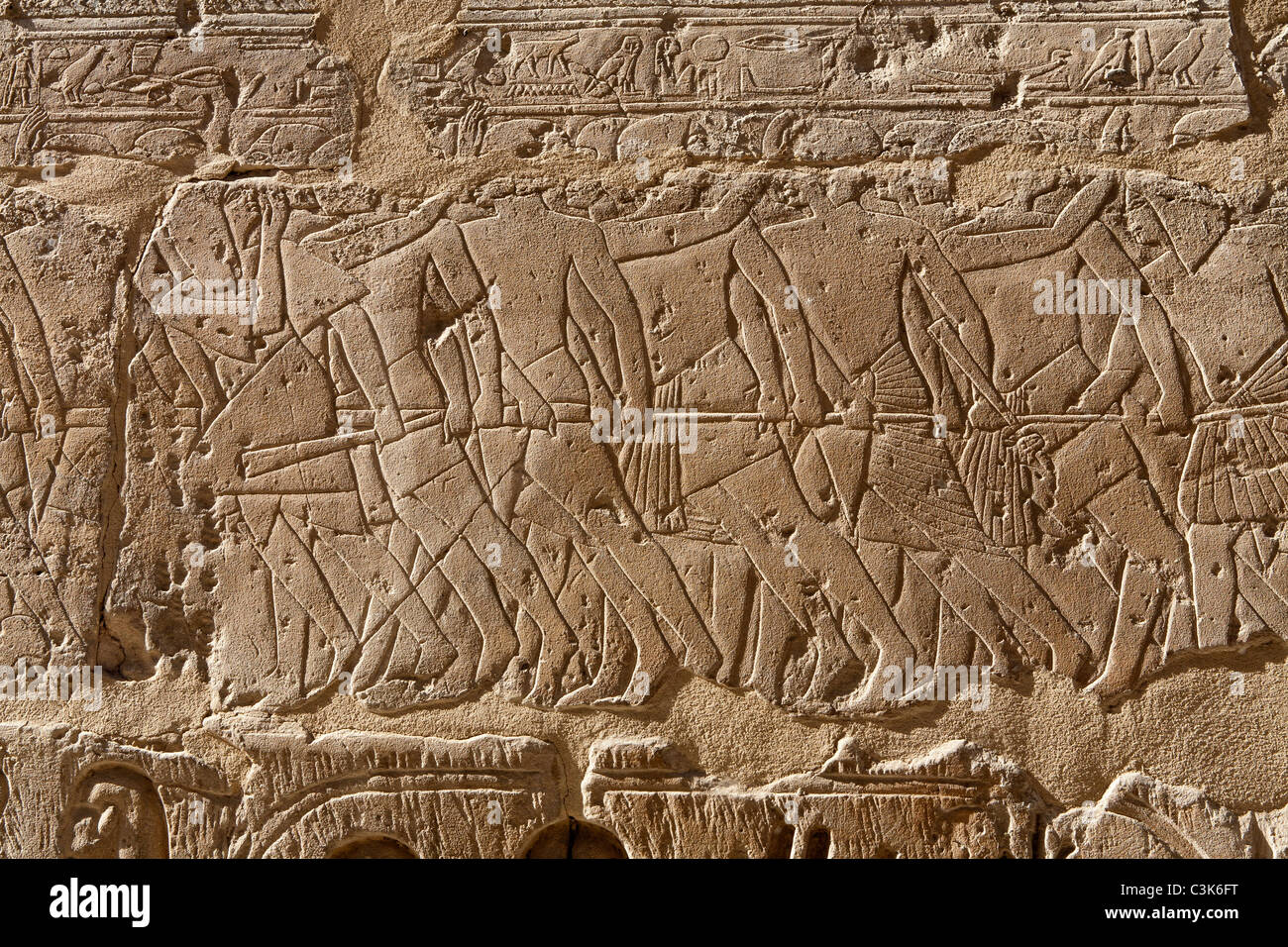 Close up of relief work on walls of the colonnade of Amehotep III Luxor Temple Egypt - Stock Image