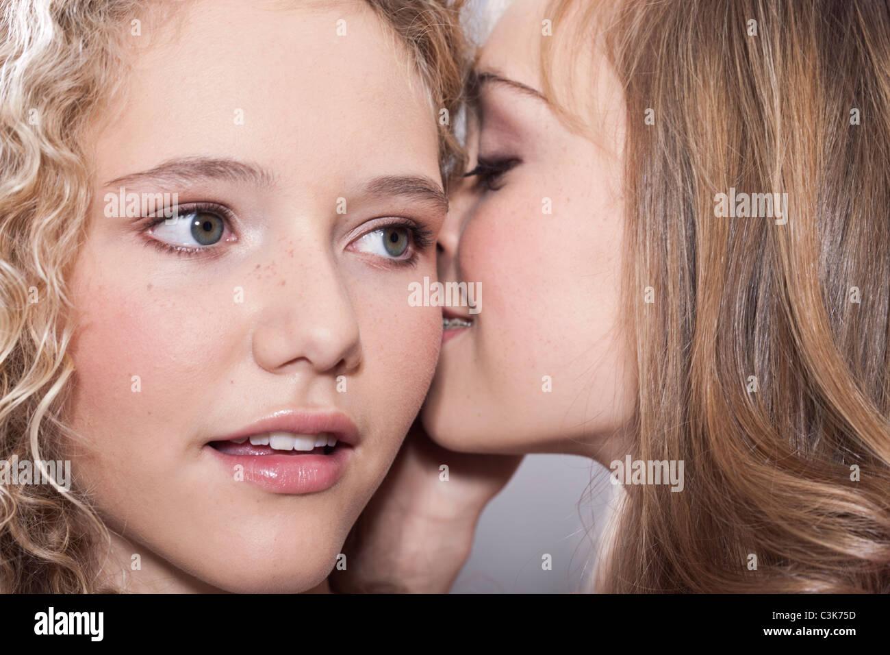 Teenage girls whispering 9