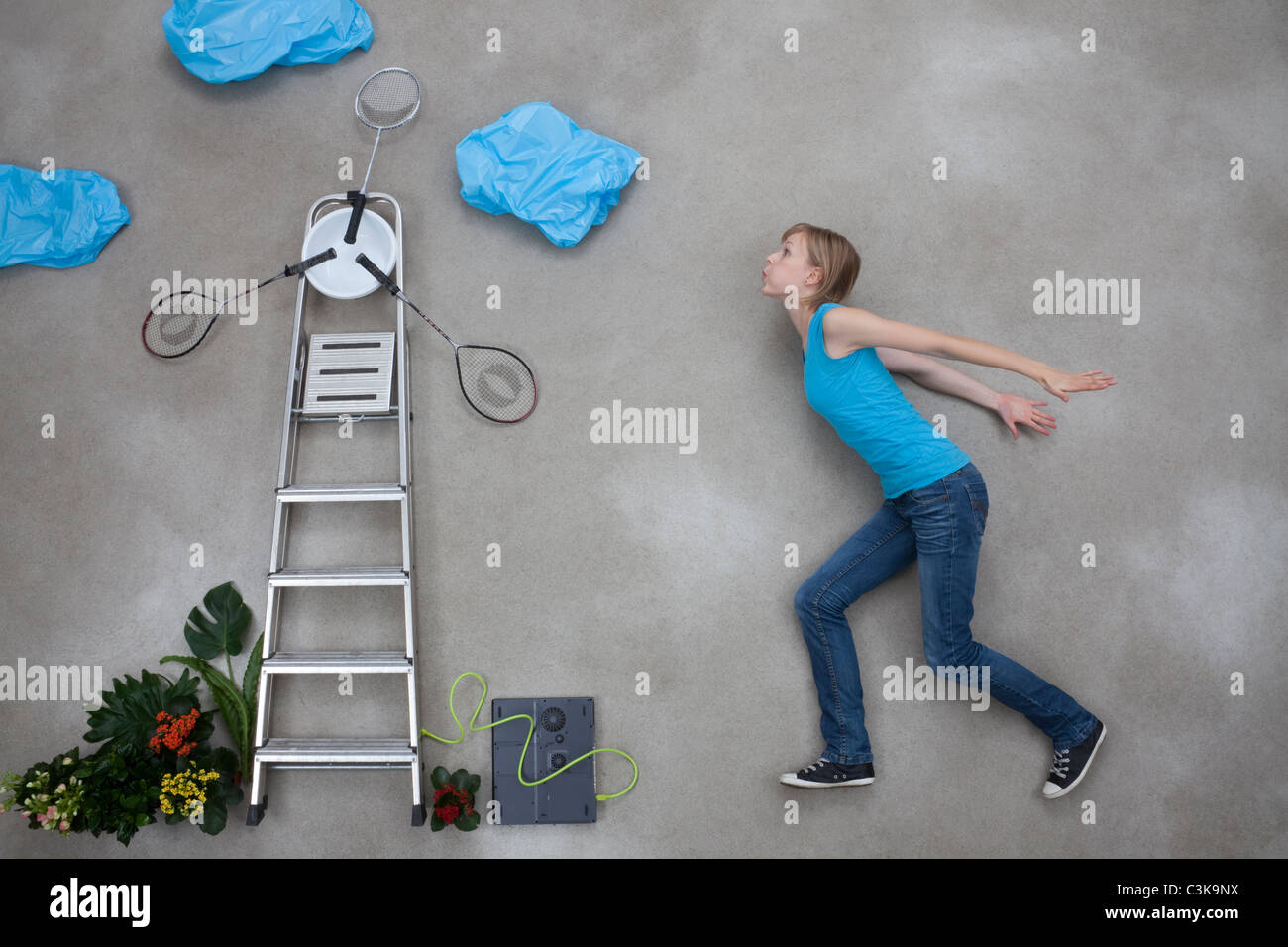 Mid adult woman blowing wind mill - Stock Image