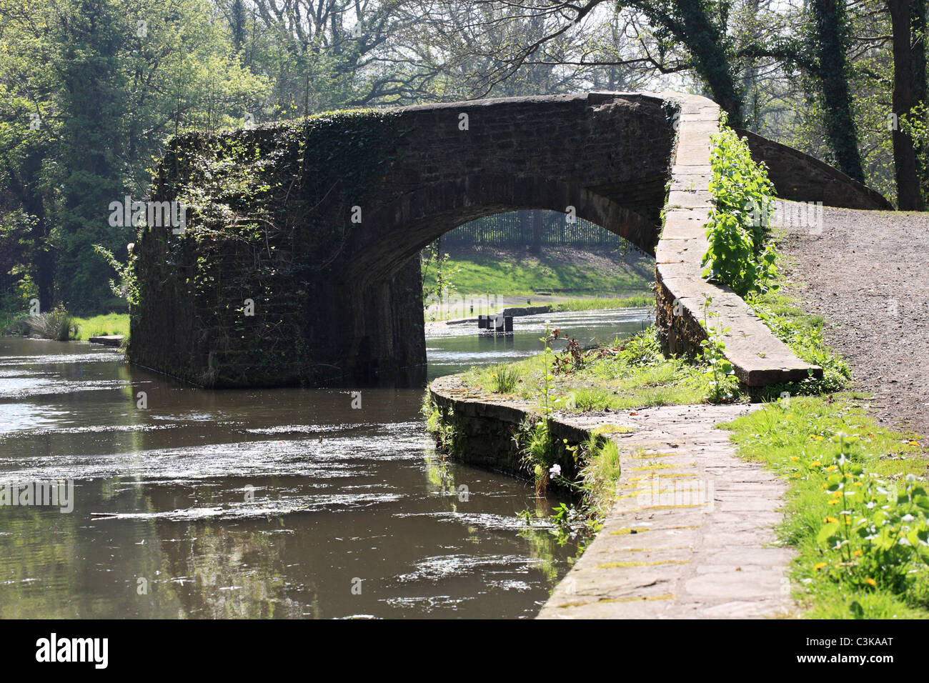 Skew bridge over the canal. Aberdulais canal basin, Neath, South Wales, UK - Stock Image