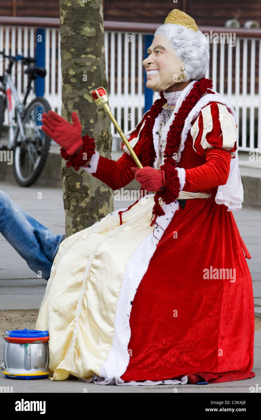 A Artist Collecting Money Dressed as HRH The Queen of England in London - Stock Image
