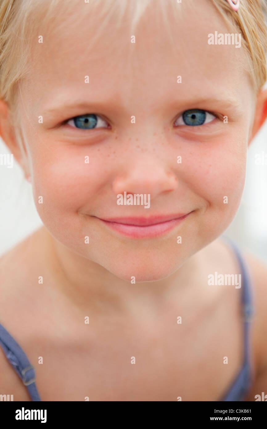 Blonde girl smiling at camera - Stock Image