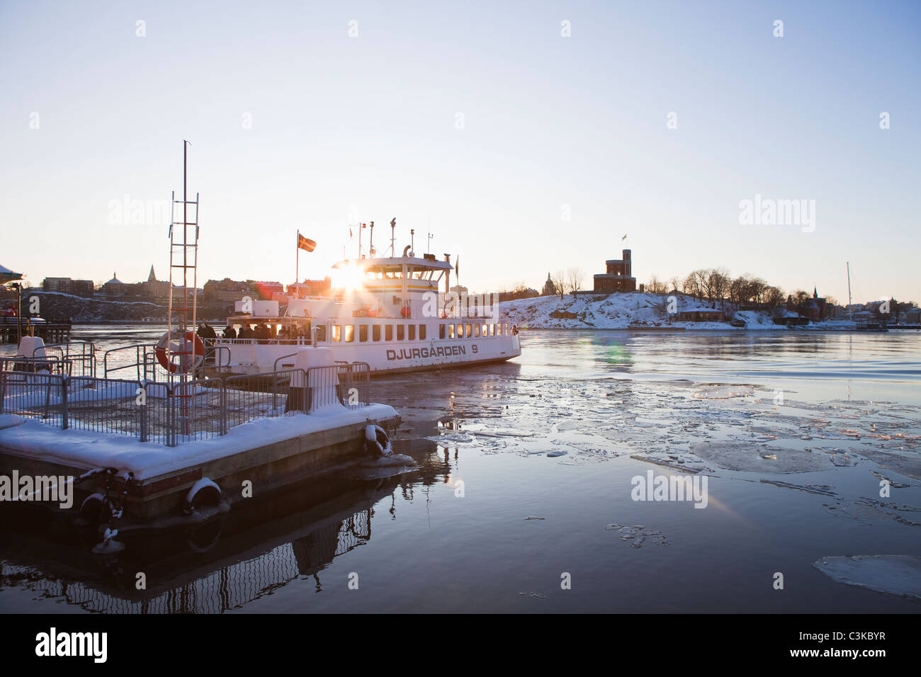 Boat on sea at dusk - Stock Image