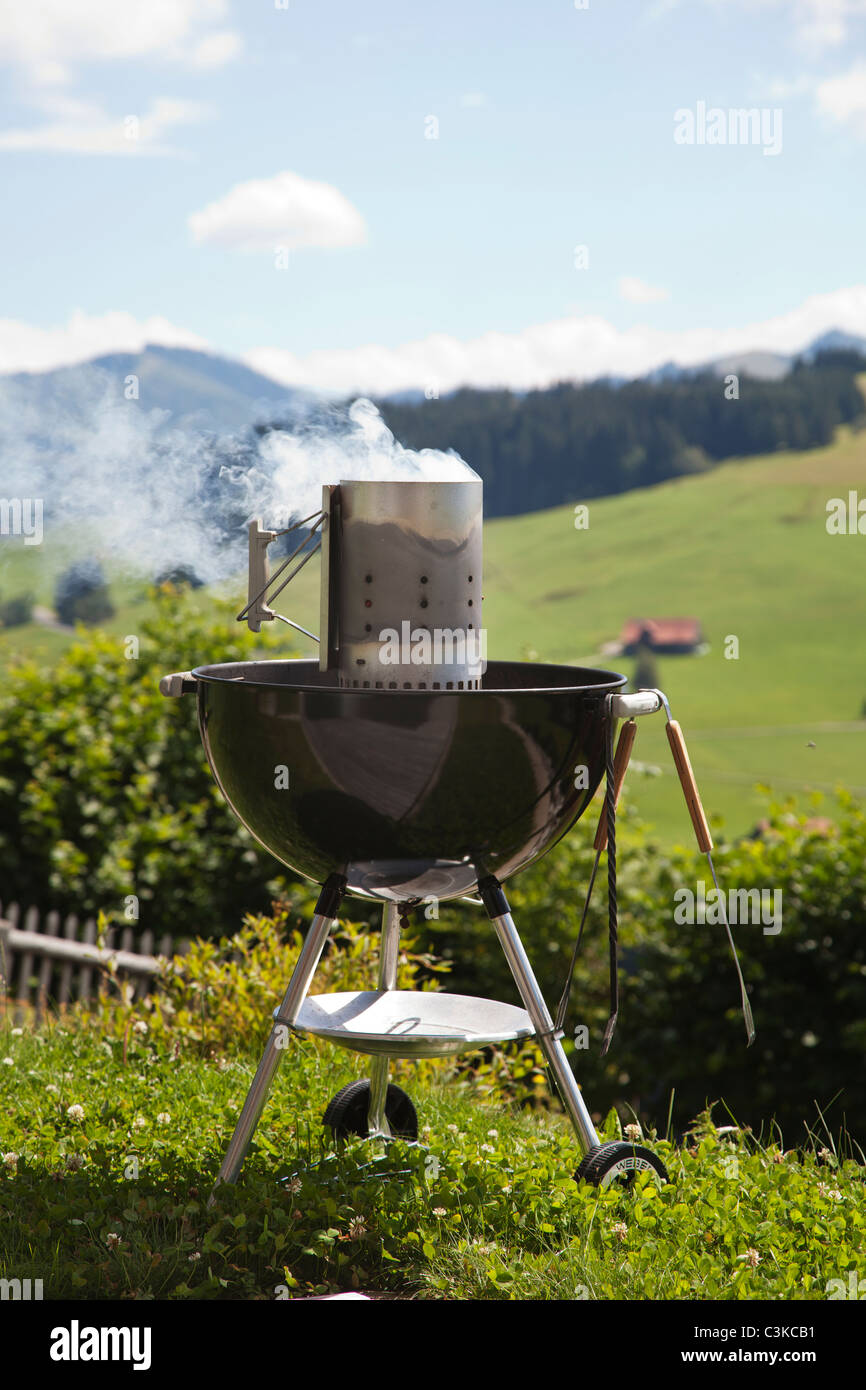 Grill with smoke going from inside - Stock Image