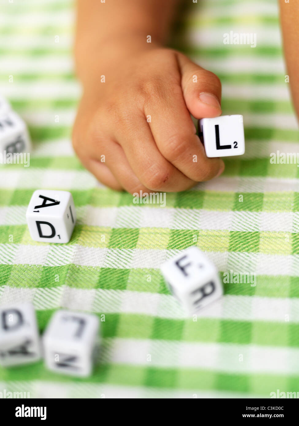 Hand of girl holding toy block with letter L Stock Photo: 36691996 ...