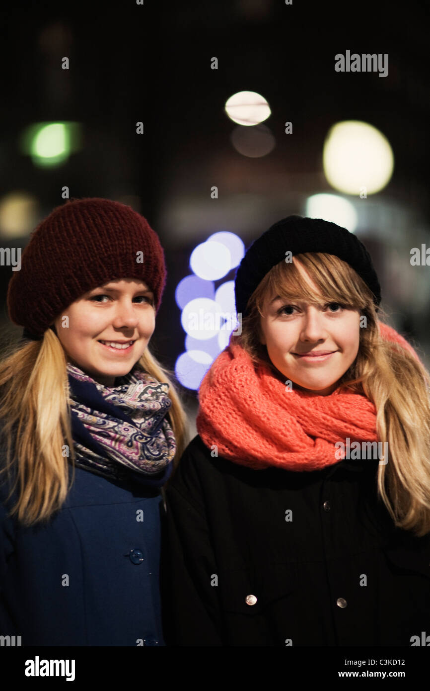 Portrait of two teenage girls in winter clothing - Stock Image