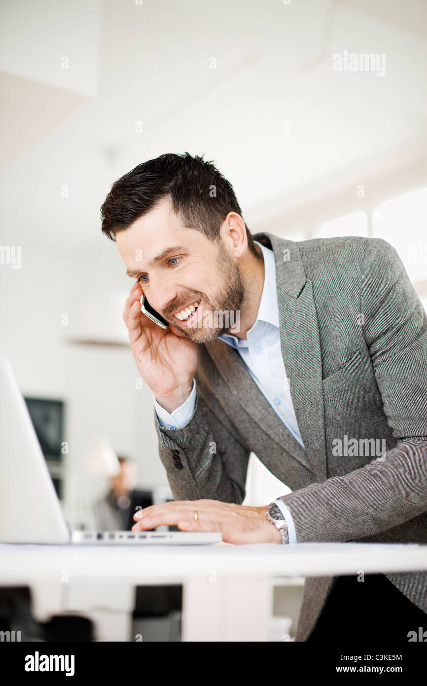 Man working in office - Stock Image