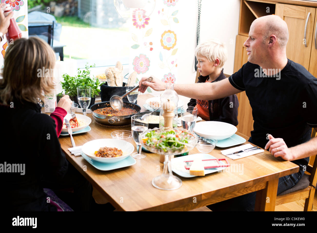 Family eating meal at restaurant - Stock Image