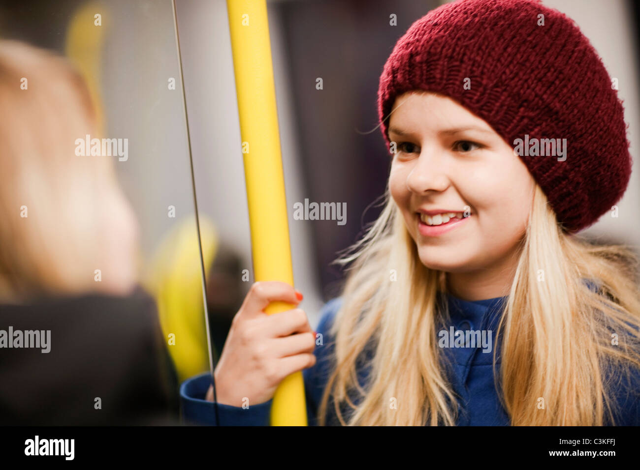 Teenage girl (14-15) in underground train - Stock Image