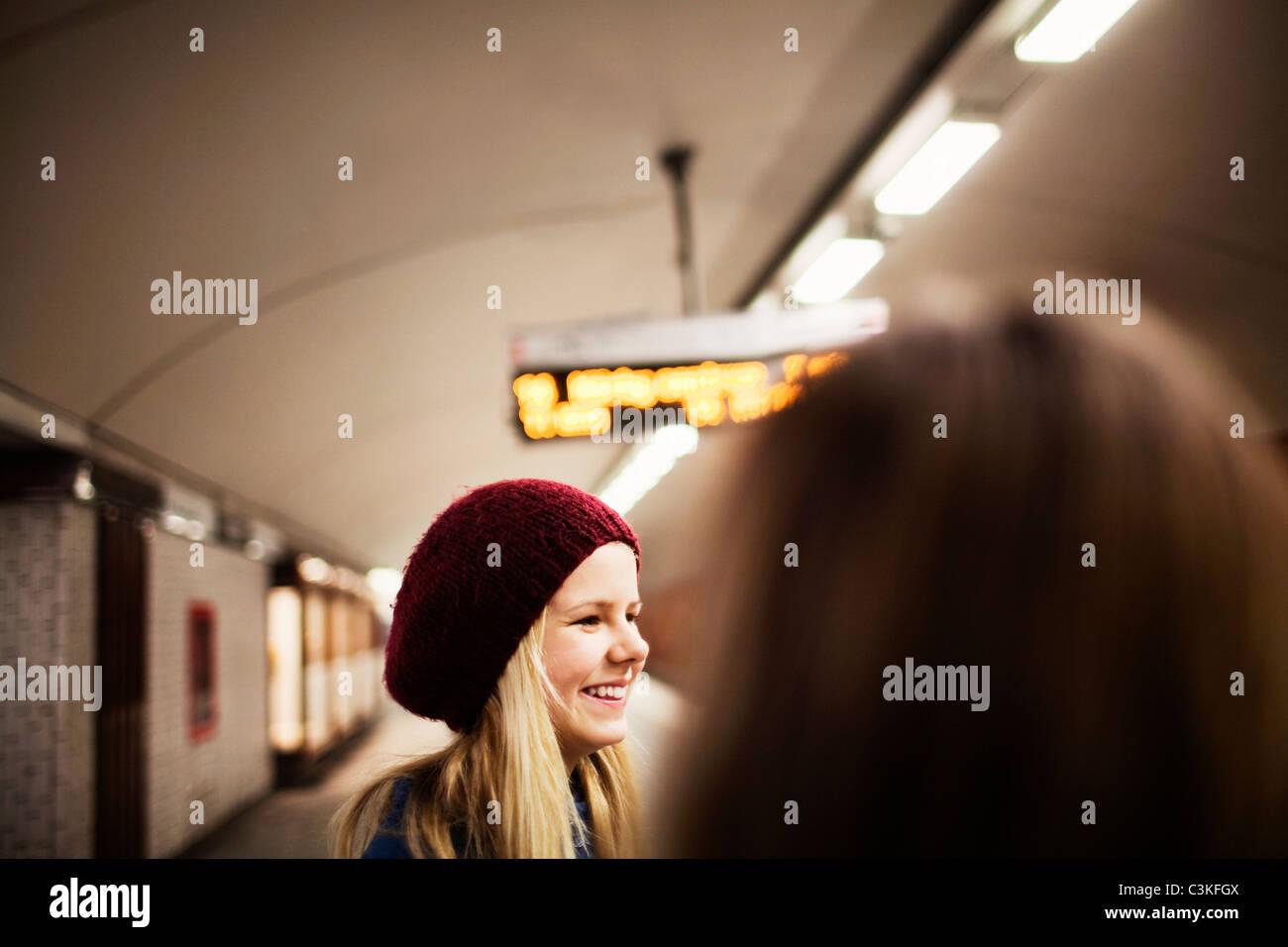 Teenage girl (14-15) standing on railway platform - Stock Image