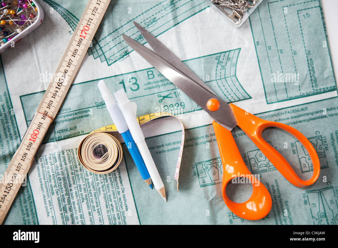 Sewing patter, scissors and tape measure, still life - Stock Image