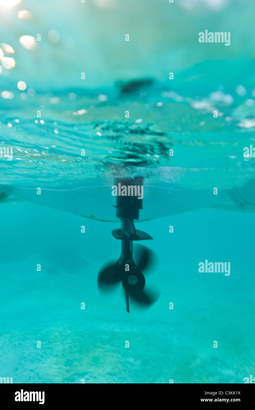 Propellor and rudder of dinghy underwater - Stock Image