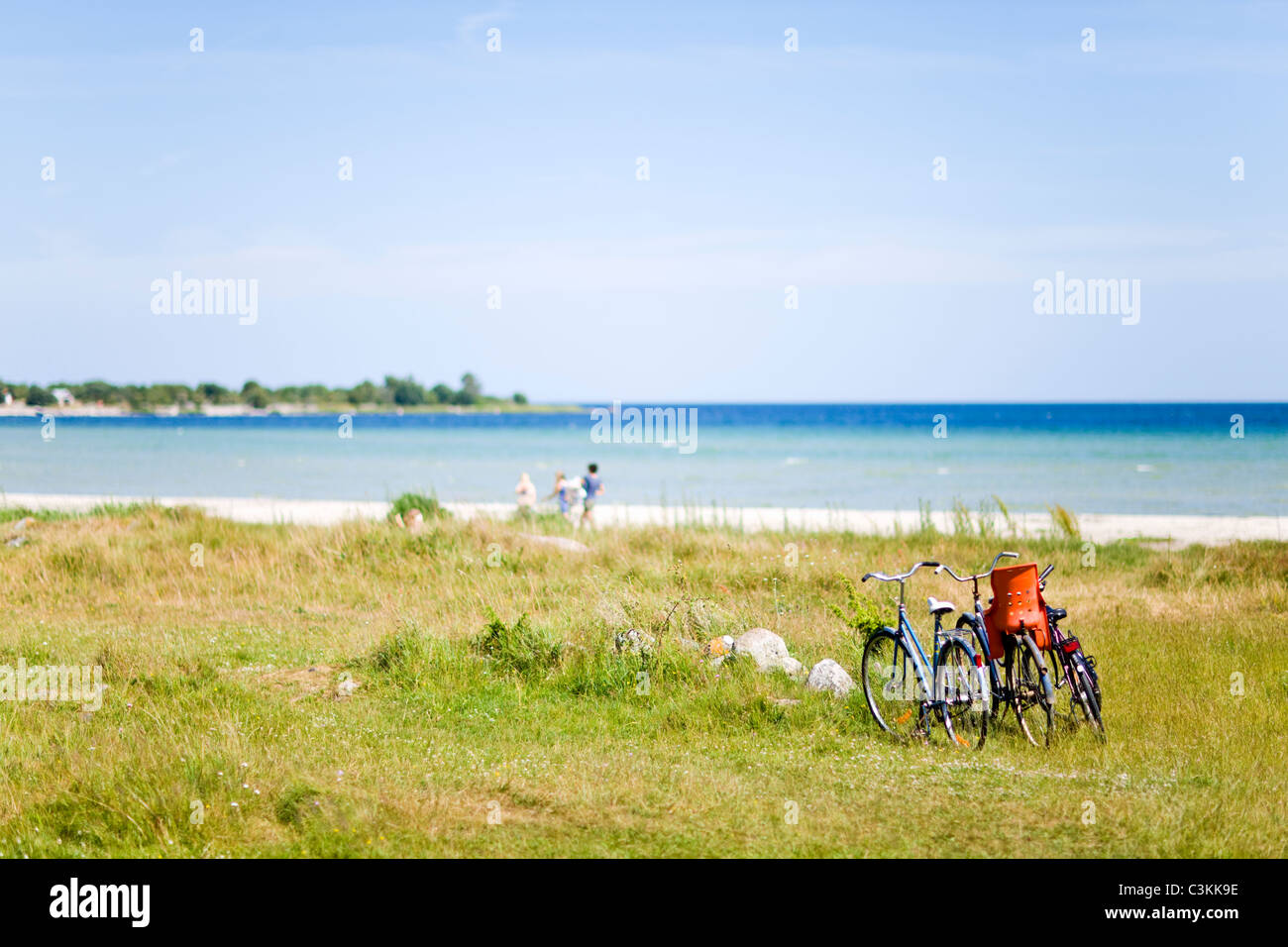 Bicycles on beach - Stock Image