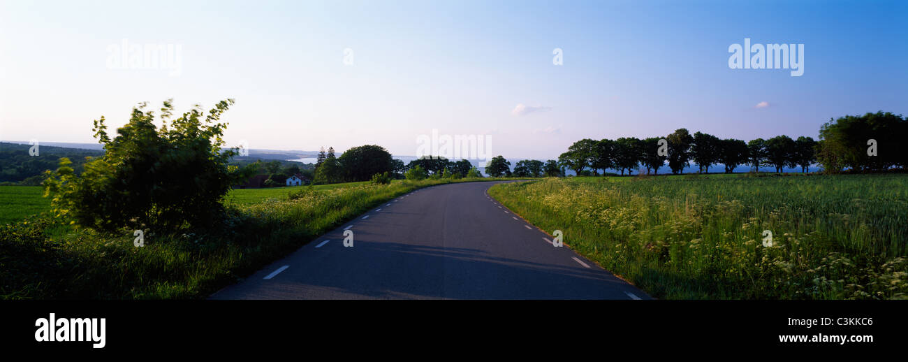 Country road passing by landscape - Stock Image