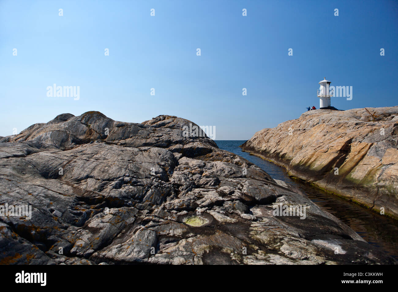 View of lighthouse on cliff - Stock Image