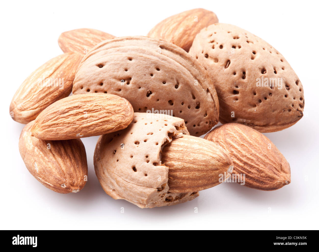Group of almond nuts with leaves. Isolated on a white background. - Stock Image