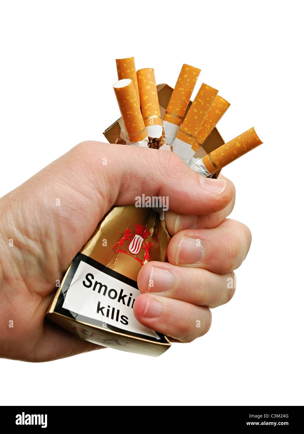 Hand Crushing a Packet of Cigarettes, Close Up, Cut Out. - Stock Image