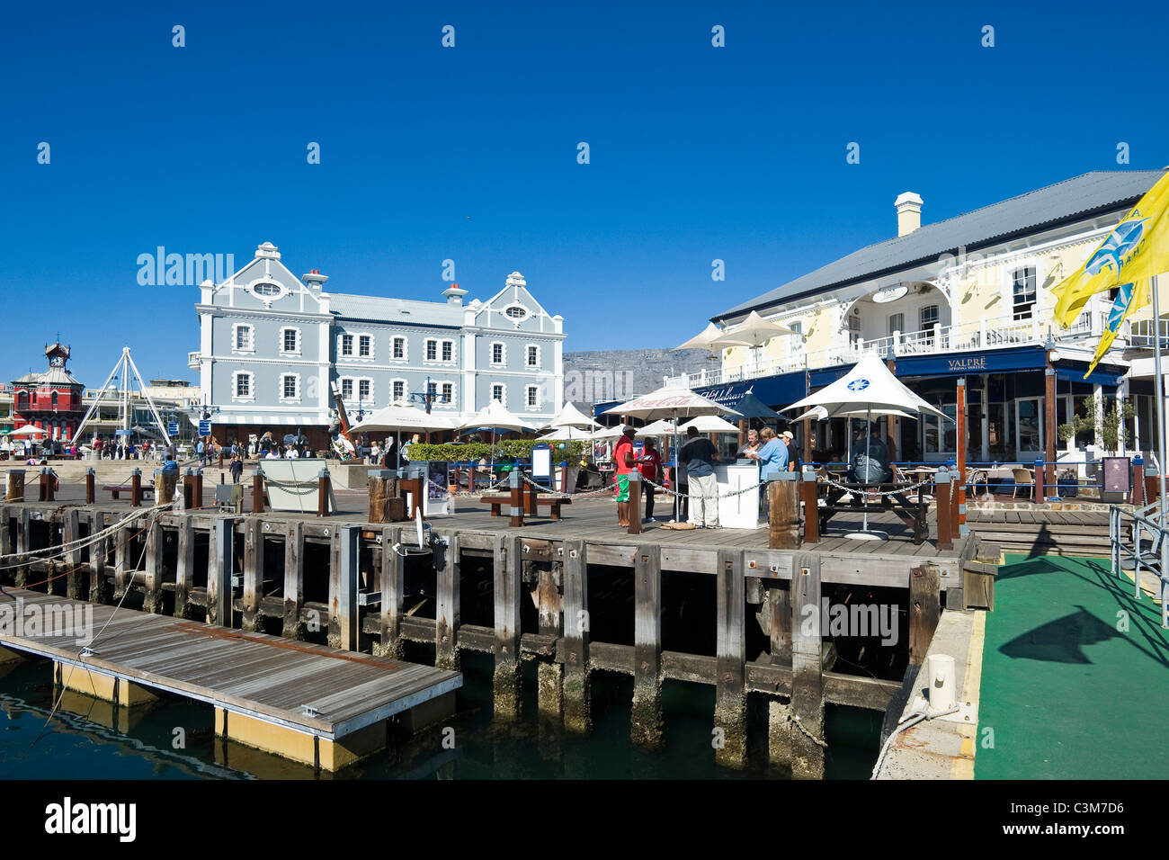 Jetty in the harbour at V&A Waterfront with African Trading Port building beyond Cape Town South Africa - Stock Image