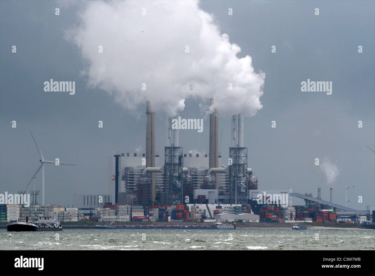 Steam from powerplant in Hollandharbour of Amsterdam - Stock Image