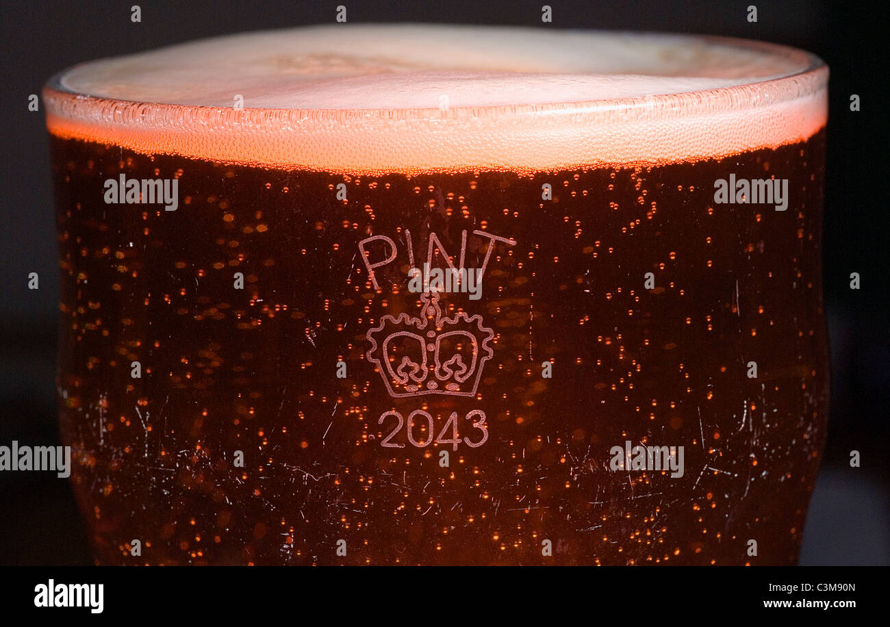 UK PINT BEER GLASS WITH CROWN STAMP - Stock Image