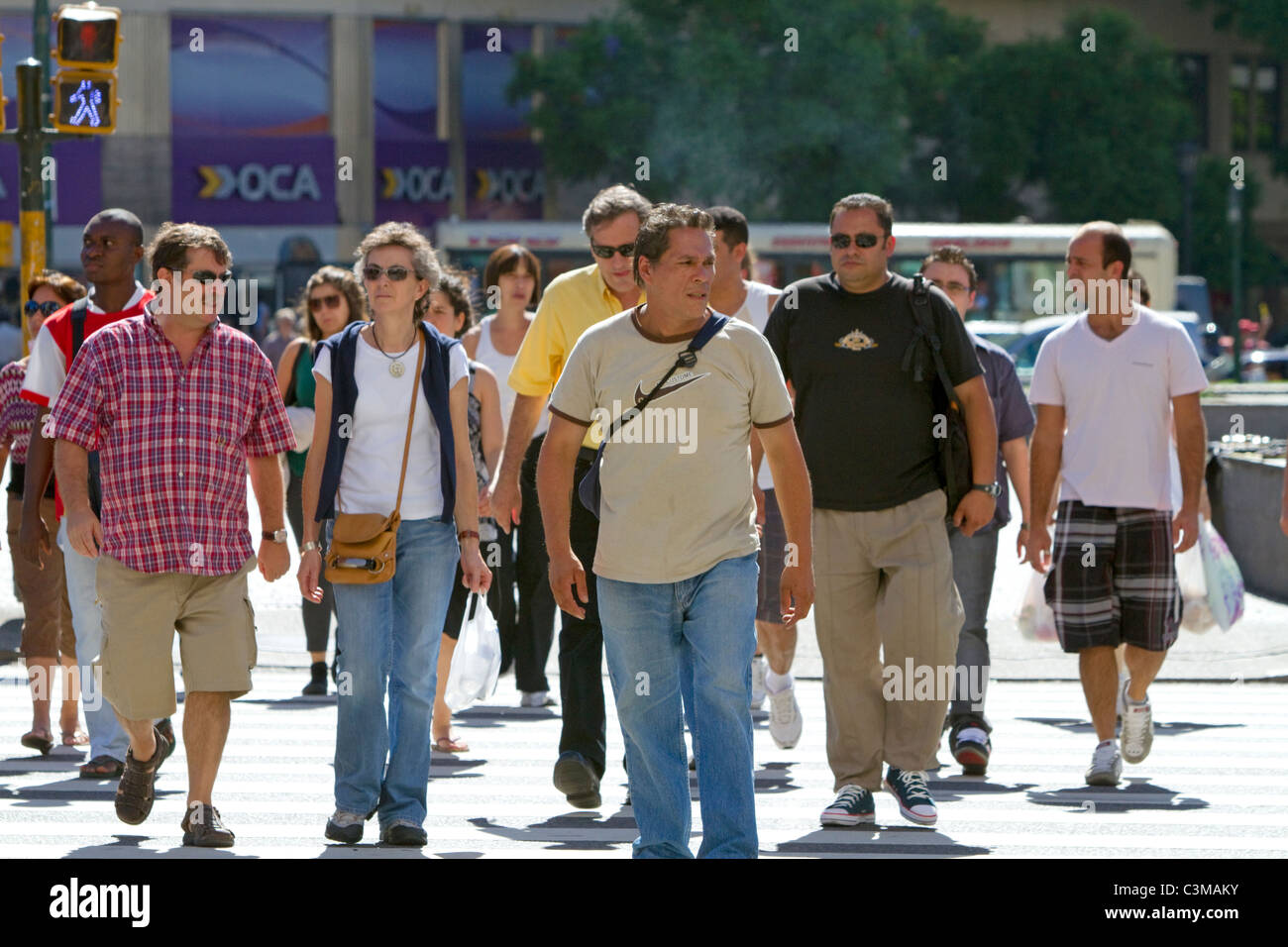 Pedestrians on Avenida 9 de Julio in Buenos Aires, Argentina. - Stock Image