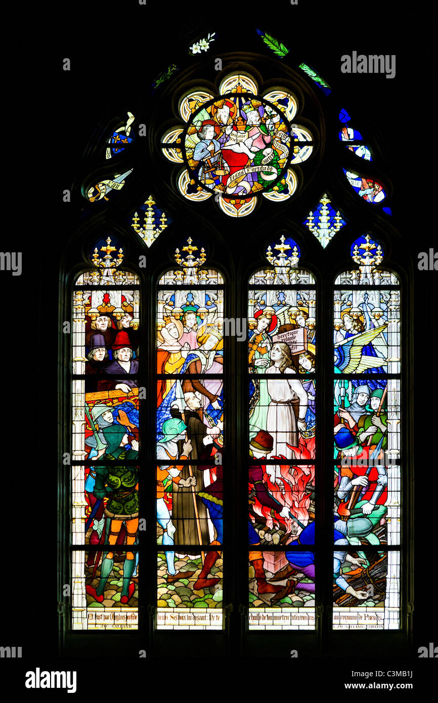 Stained glass window showing the burning of Joan of Arc, Orleans Cathedral (Cathedrale Sainte Croix d'Orleans), - Stock Image