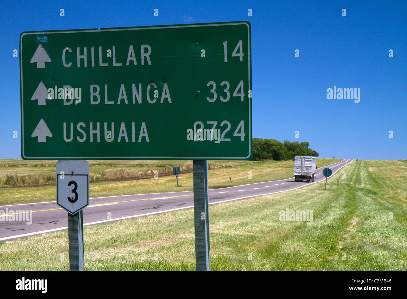 Road sign showing distance in kilometers along Highway 3 south of Azul, Argentina. - Stock Image