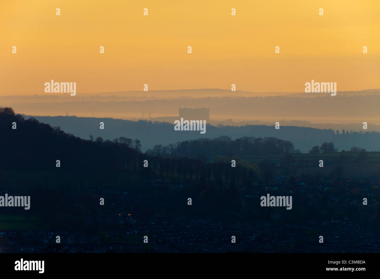 Dusk falling on Oldbury nuclear power station viewed from the Cotswolds across the intervening town of Dursley, - Stock Image