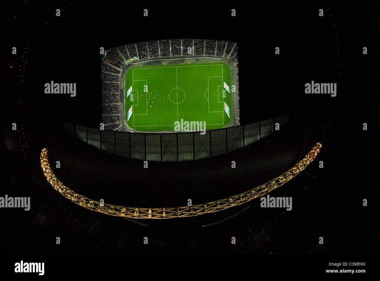 Wembley stadium at night photographed directly from above showing the arch and England international below - Stock Image