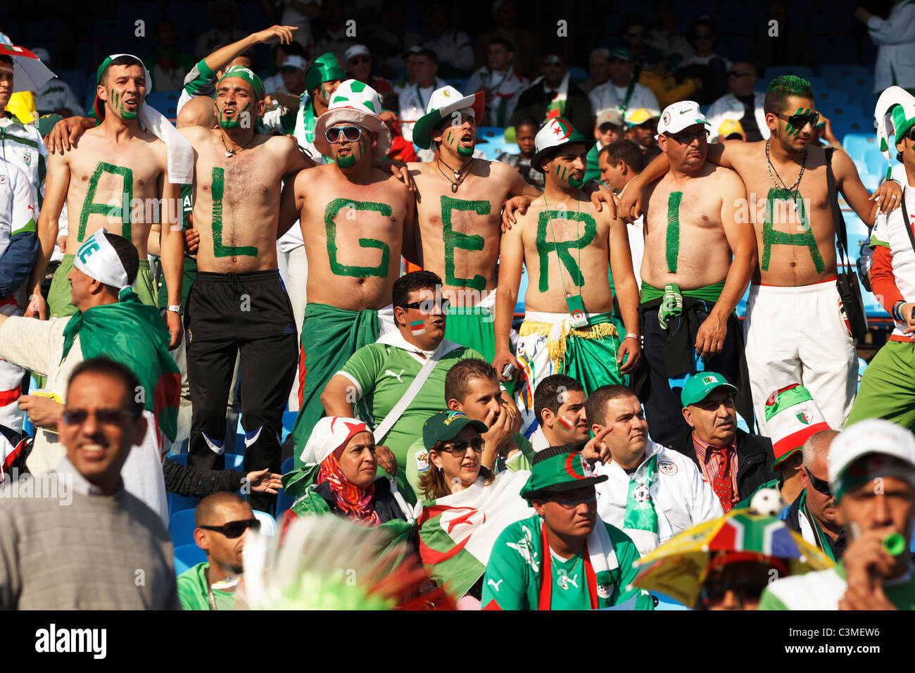 Algeria supporters with painted chests cheer at a 2010 FIFA World Cup Group C match between the United States and - Stock Image