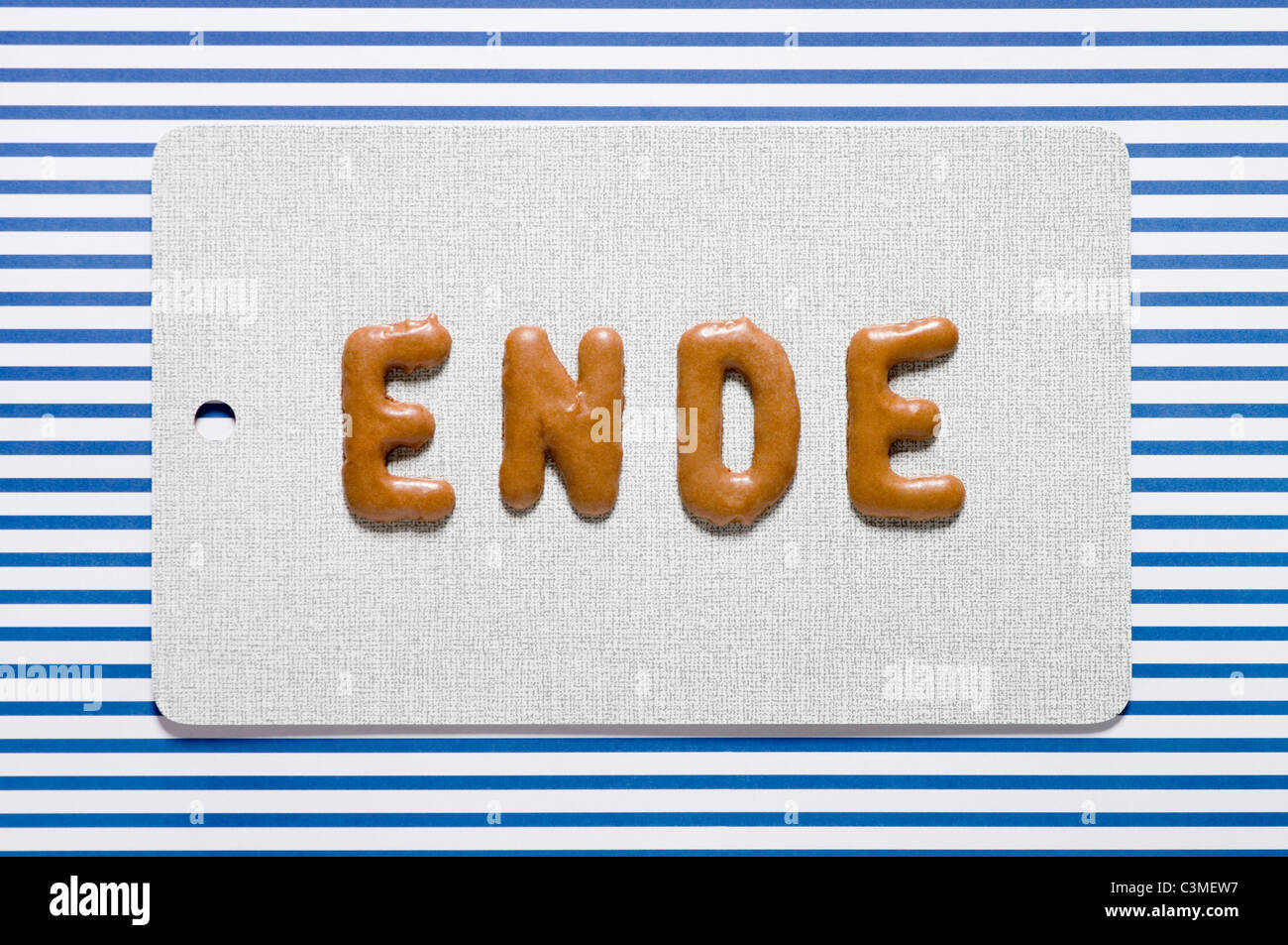 Word end written with russian bread on dish, close up - Stock Image