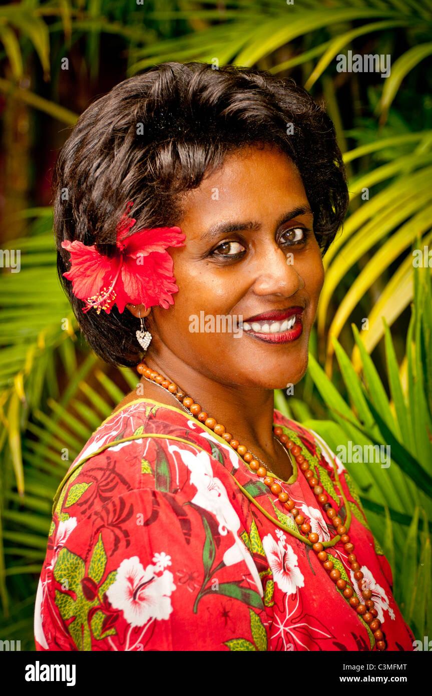Fijian woman greets guests at Castaways Resort, Quilto Island, Mamanucas, Fiji - Stock Image