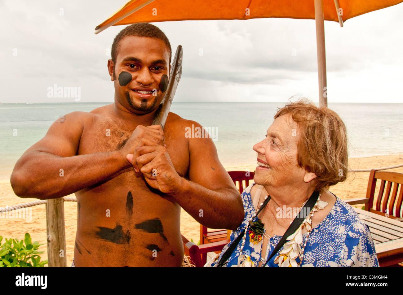 Traditional Fijian Warrior greeting guest a Five Star, Likuliku Lagoon Resort, Malolo Island, Mamanucas, Fiji - Stock Image