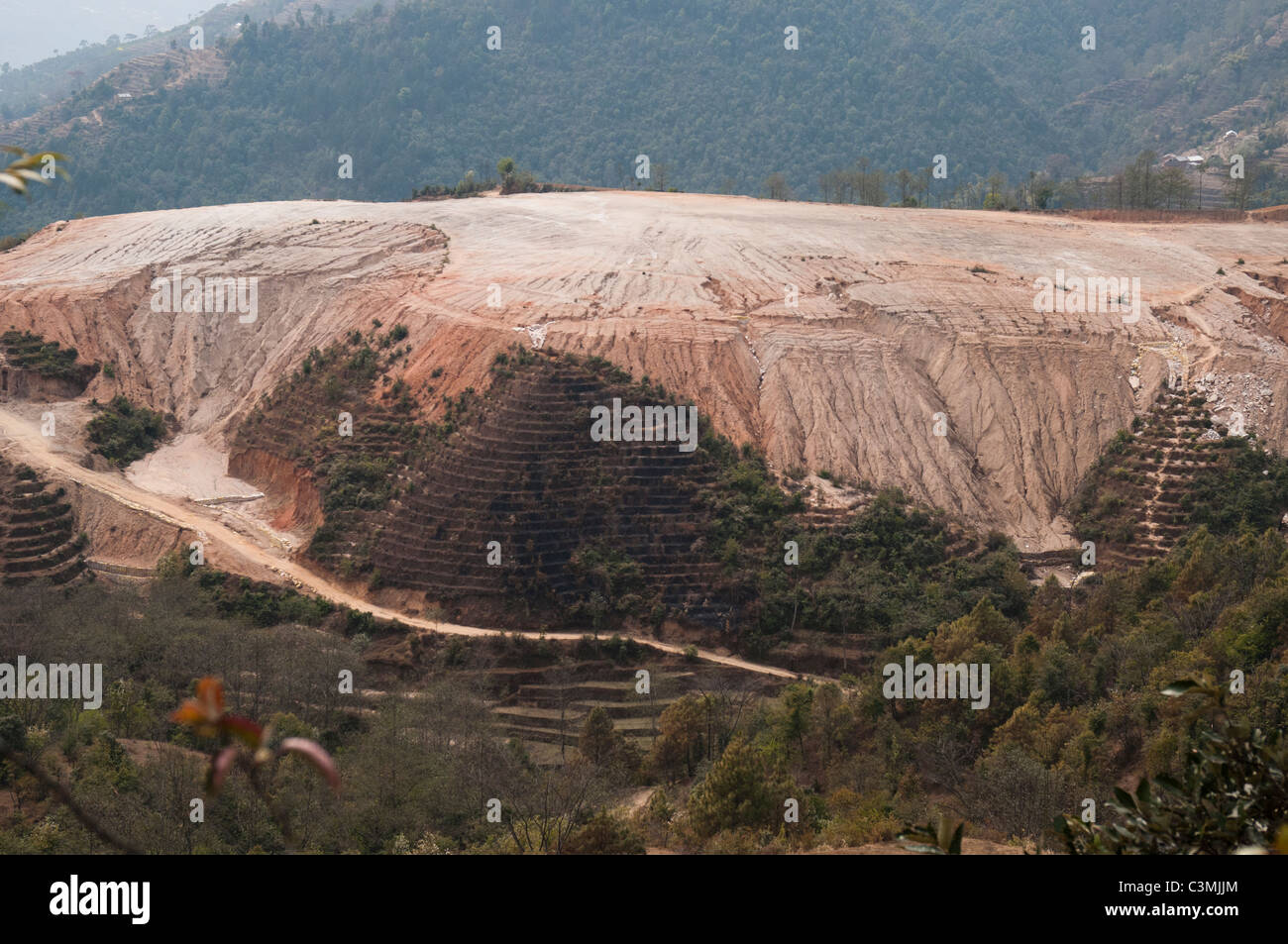 Inappropriate development underway in hill country outside Kathmandu - Stock Image