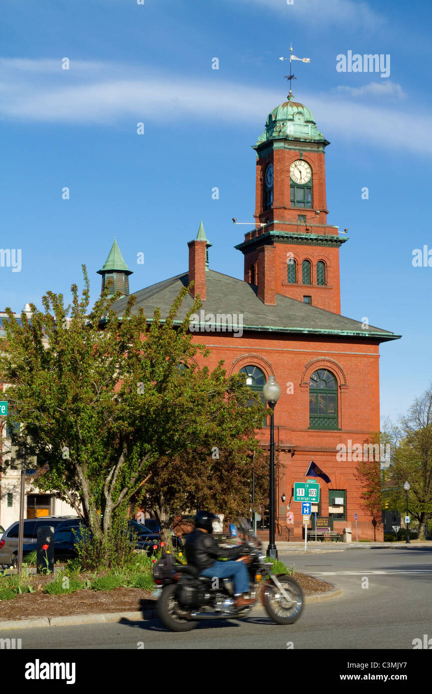 Motorcycle touring Claremont, NH Opera House in spring sun. New Hampshire, New England, USA. - Stock Image