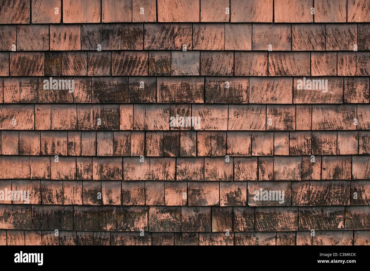 Shabby shingle siding in need of renovation. - Stock Image