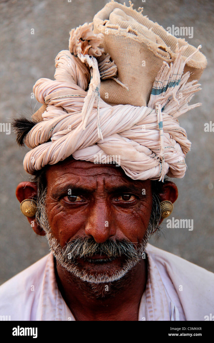 gloomy face of indian farmer - Stock Image