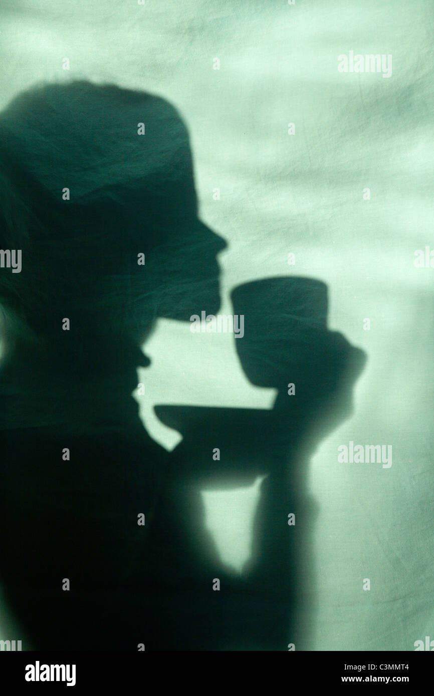 shadow of girl with the cap of tee - Stock Image