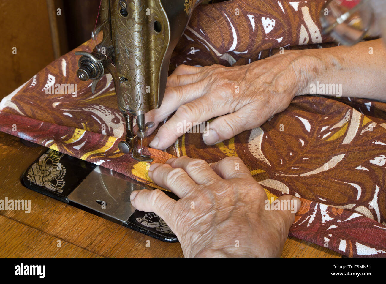 hands of old woman by the needlework - Stock Image