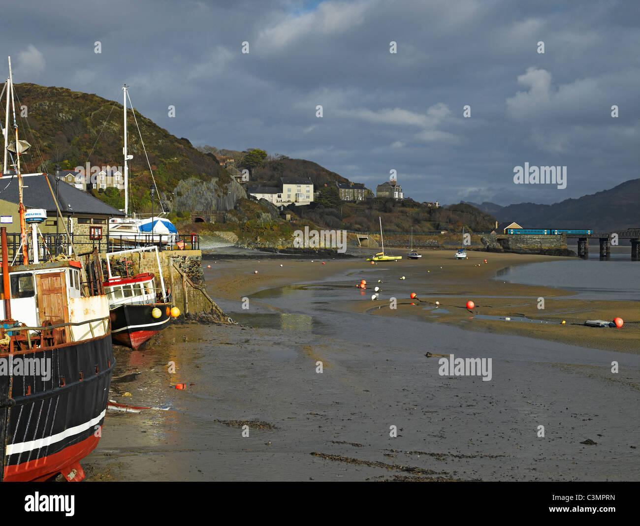 Fishing boats at low tide Barmouth Gwynedd Wales UK United Kingdom GB Great Britain Stock Photo