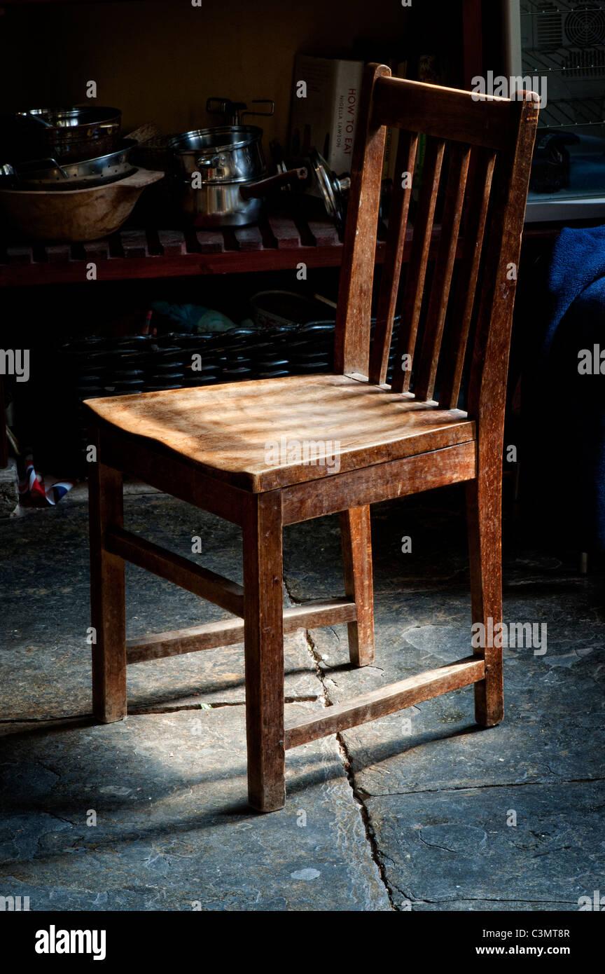 Old Oak Wooden Kitchen Chair On A Welsh Slate Floor Stock Photo Alamy