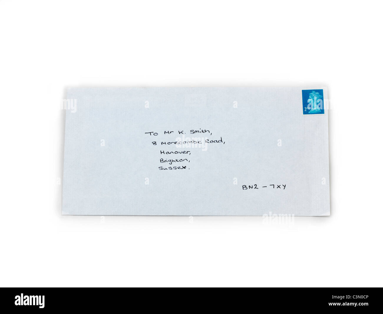 A Letter In An Envelope With A Stamp Stock Photo