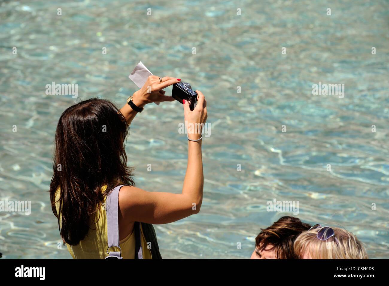 italy, rome, trevi fountain, tourist taking photos - Stock Image
