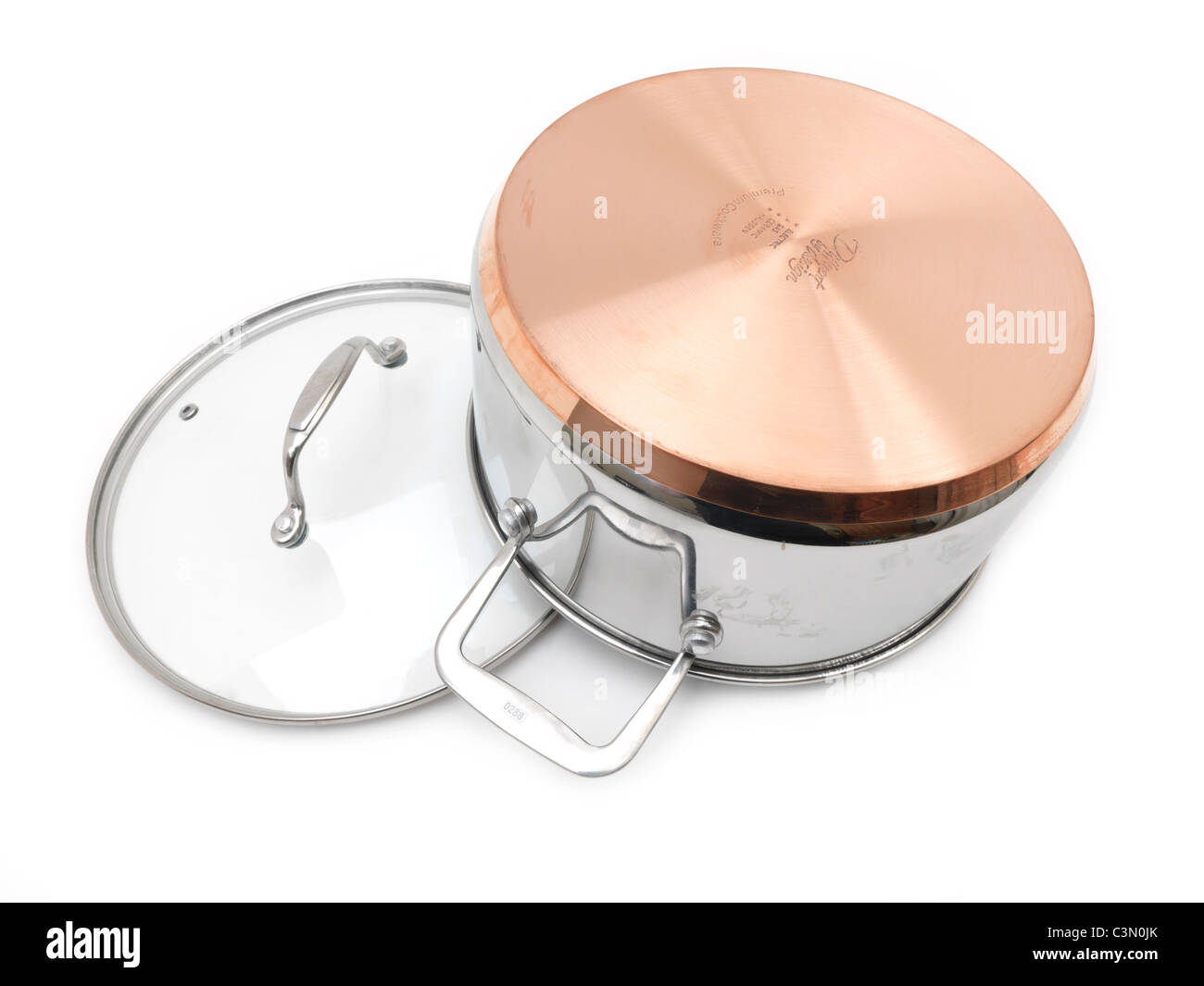 Copper Bottom Cooking Pot With Glass Lid - Stock Image
