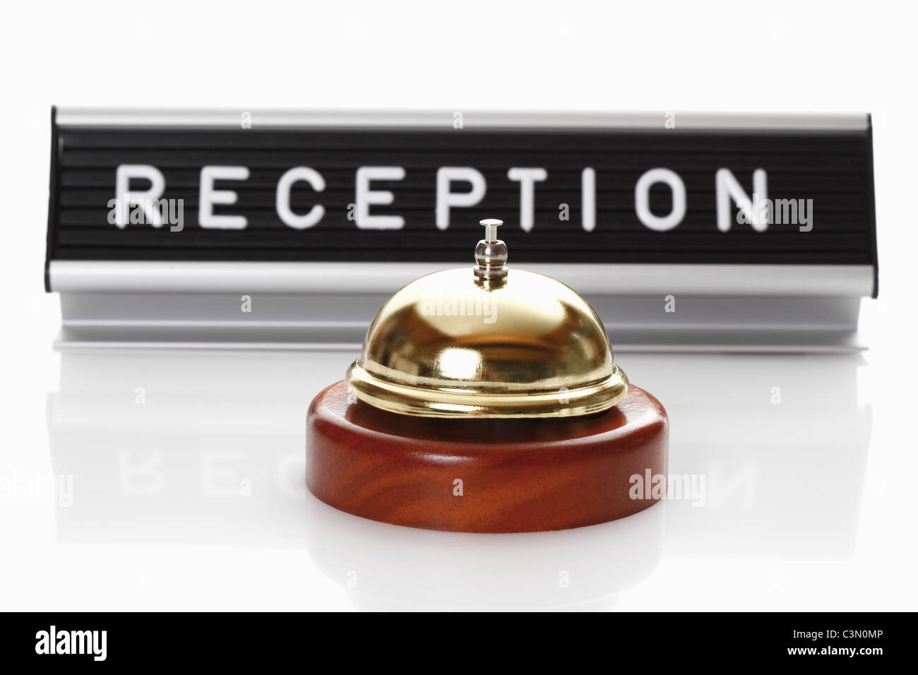 Reception sign with service bell on white background - Stock Image
