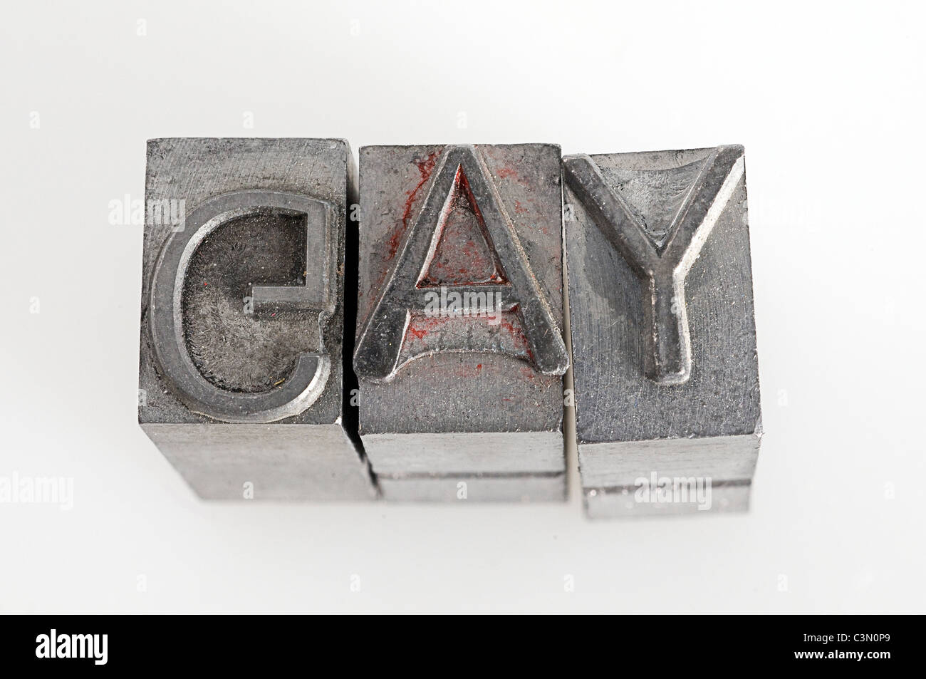 the word gay using type,c,a,y, letter, type, lettering, set, metal, numbers, typeset, writer, typesetting, closeup, - Stock Image