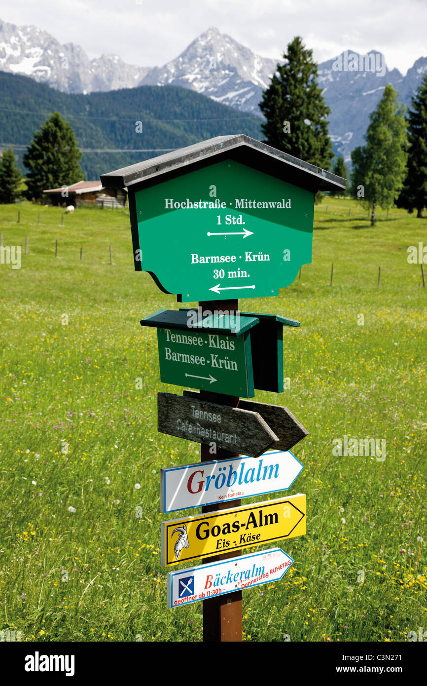 Germany, Bavaria, Sign board in hump-meadow with karwendel mountains in background - Stock Image